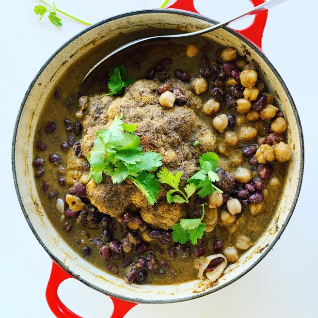 Jamaican Jerk Whole Roasted Cauliflower with Black Beans and Chickpeas